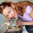 Portrait of the girl with the iguana - Stock Photo