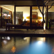 Night pool and terrace for rest behind — Stock Photo