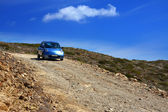 The car on a dirt road on a mountain slope. Greece. Rhodes — Stock Photo