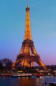 Eiffel Tower illuminated at night. View from the Seine quay. March 14, 2012 in Paris, France. — Stock Photo
