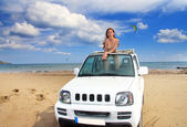 Greece. Rhodes. The young beautiful woman in the car on seacoast — Stock Photo