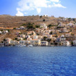 Greece. Dodecanesse. Island Symi (Simi). Colorful houses on rocks. — Stock Photo