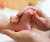 Baby massage — Stock Photo
