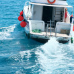 Tourist boat on the sea — Stock Photo