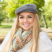 Beautiful and smiling blond woman — Stock Photo
