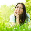 Beauty young woman relaxing on grass — Stock Photo