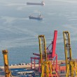 Cranes and cargo ships at the Port of Barcelona - Foto Stock