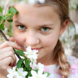 Beautiful Girl in the flowers garden — Stock Photo #10442906