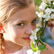 Beautiful blond girl in garden — Stock Photo