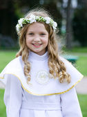 Première communion - jeune fille souriante — Photo