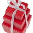 Red gift boxes with silver ribbon. — Stock Photo #8055576