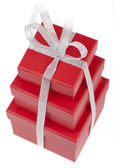 Red gift boxes with silver ribbon. — Stock Photo