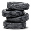 Four tires on the white background — Stockfoto
