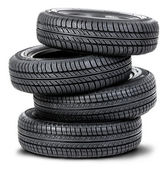 Four tires on the white background — Stock Photo