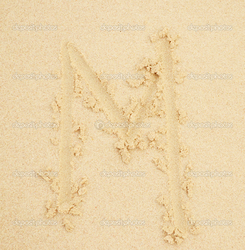 M letter written in the sand  Stock Photo #9319171