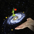 Flower at center of galaxy.Elements of this image furnished by - Foto de Stock  