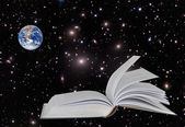 Planet Earth on book.Elements of this image furnished by NASA — Stock Photo