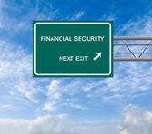 Road sign to financial security — Stock Photo