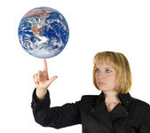 Planet earth on finger — Stock Photo