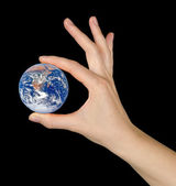 Planet earth in fingers.Elements of this image furnished by NASA — Stock Photo