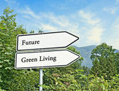 Road signs to future and green living — Stock Photo