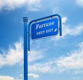 Road sign to fortune — Stock Photo