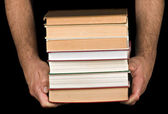 Books in hands — Stock Photo