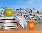 Green apple on open book — Stock Photo