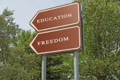 Road sign to eduacation and freedom — Stock Photo