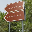 Road sign to happiness and healthy life — Stock Photo