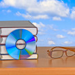 DVD, eyeglasses, and books — Stock Photo #9667390