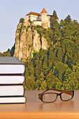 Books and eyeglasses — Stock Photo