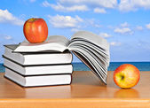 Red apple on open book — Stock Photo