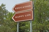 Road sign to eduacation and happy life — Foto de Stock