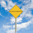 Road sign to achievement — Stockfoto #9670443