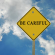 Road sign to be careful — Stockfoto