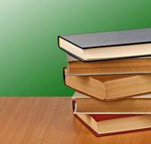 Books on desk — Stockfoto