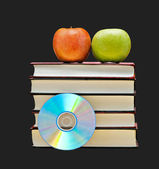 Apples, dvd, and books as symbols of transition fron old to ne — Stock Photo
