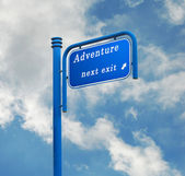 Road sign to adventure — Stock Photo