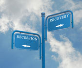 Road sign to recovery and recession — Stock Photo