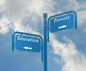 Road sign to education and poverty — Stock Photo