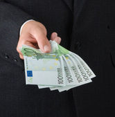Hand with euro banknotes — Stock Photo