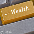 Keyboard with key for wealth — Stock Photo #9706116