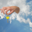 Gift of key from sky — Stock Photo