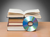 Open book and DVD as symbols of old and new methods of informat — Stock Photo