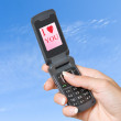 Mobile phone with picture of heart - Stock Photo