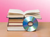 Open book and DVD as symbols of old and new methods of informat — Foto Stock