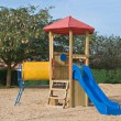 A colorful public playground in a garden — Stock Photo #9723298