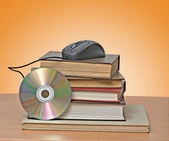 Books, dvd, and mouse — Foto Stock