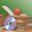Apple, dvd, and books as symbol of transition from old to new — Stock Photo #9739145